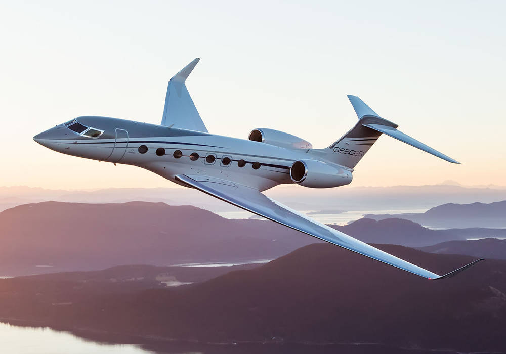 Gulfstream G650ER flying during sunset