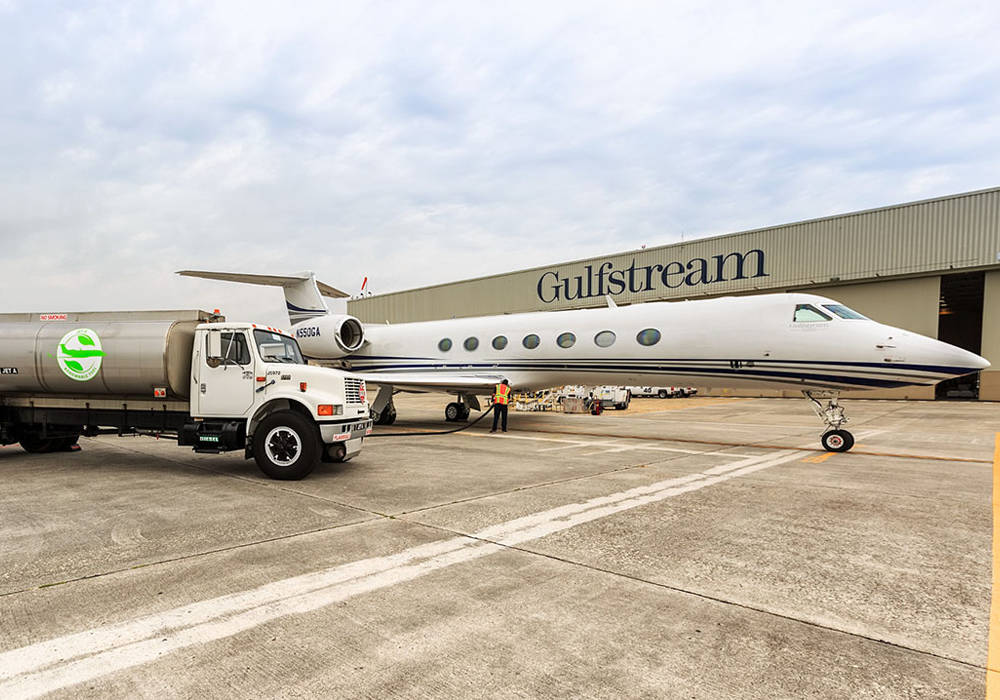 Gulfstream jet next to sustainable aviation fuel truck
