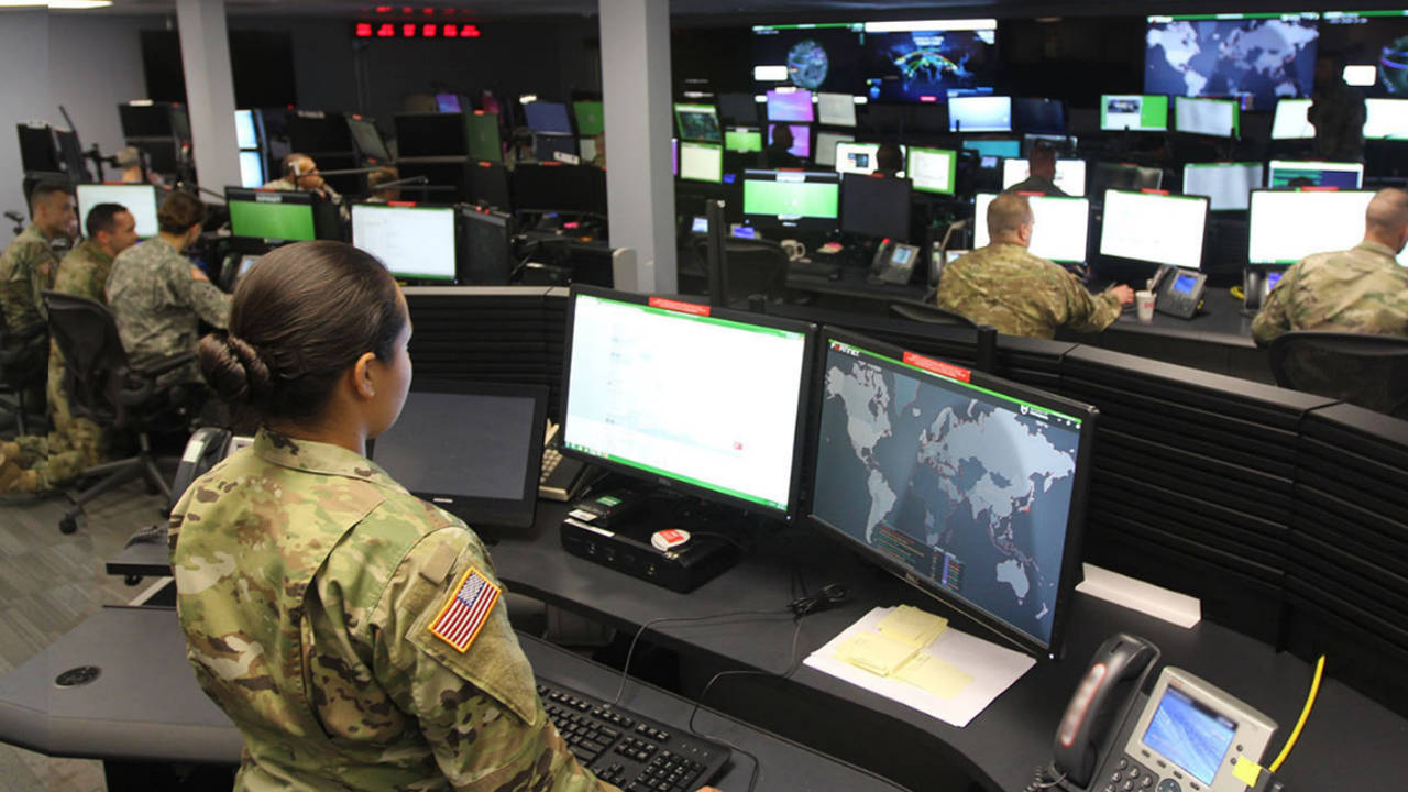 female solider in a command center